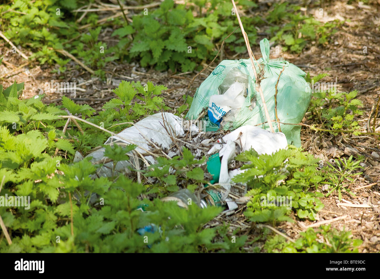 Garbage dumped outdoors - Stock Image