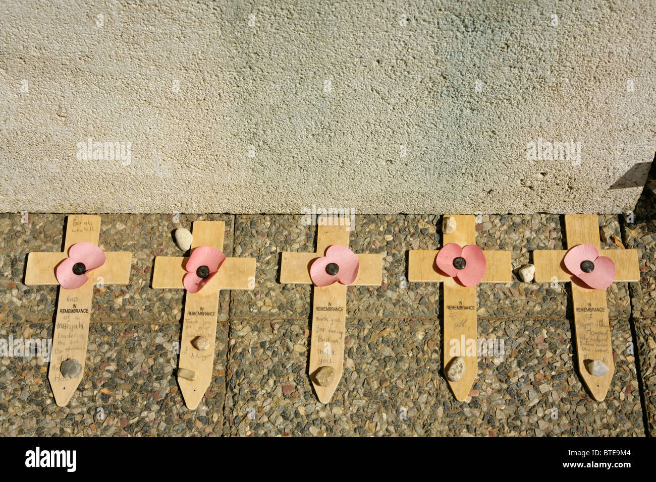 Row of five Remembrance Day poppies and crosses at Pegasus Bridge, over the Caen Canal, France. - Stock Image