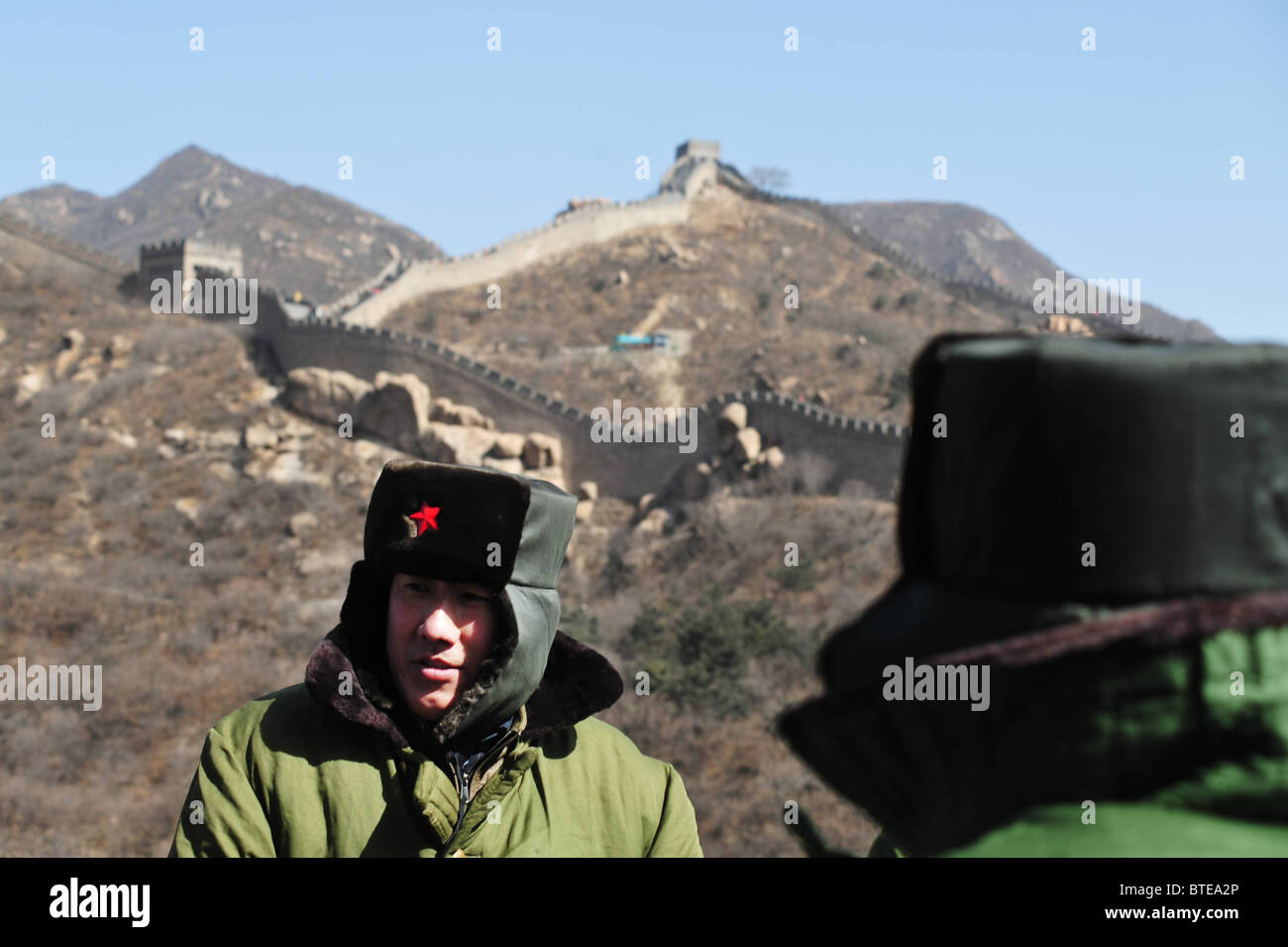 Chinese soldiers wear hats with the chinese military army red star symbol  on the Great Wall 8571d5e1dc2