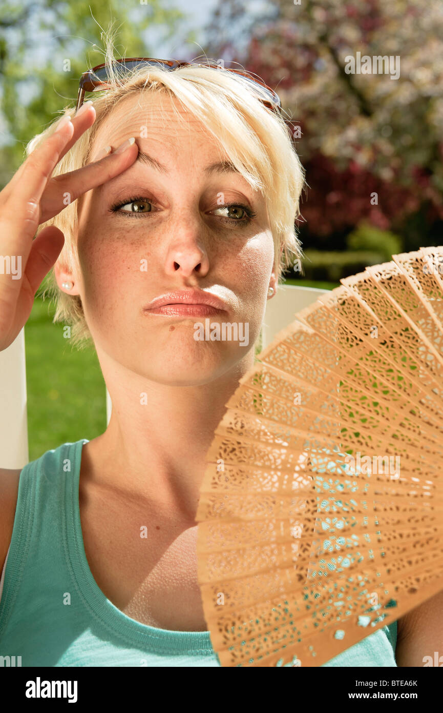 Woman suffering from the summer heat - Stock Image