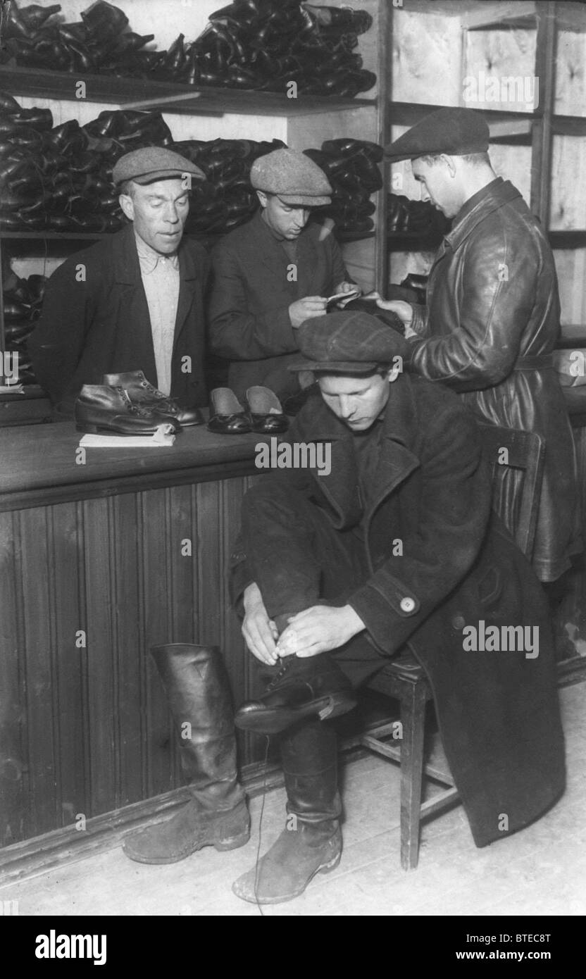 Shoes purchase in members-only outlet of Moscow factory, 1930 - Stock Image