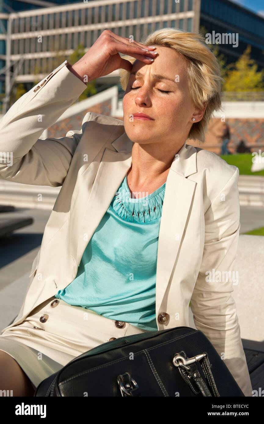 Young woman suffering from vertigo - Stock Image