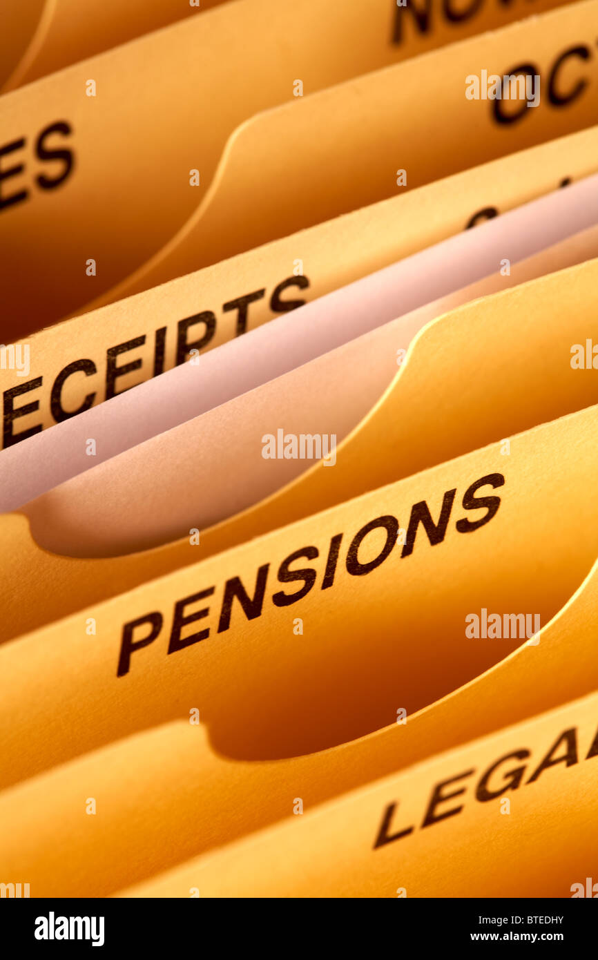 expanding personal accounts file compartments close up focus on PENSIONS - Stock Image