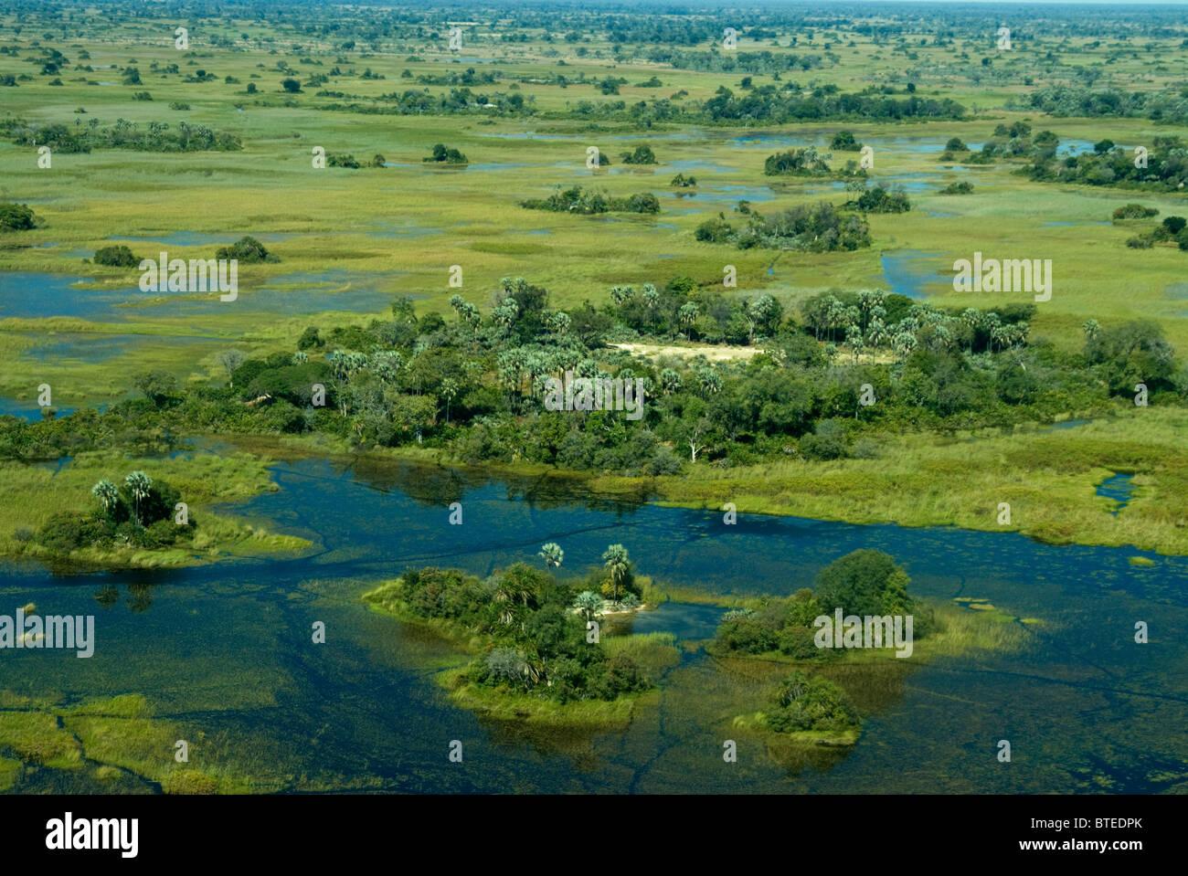 Aerial scenic view of the Okavango delta showing islands and waterways - Stock Image