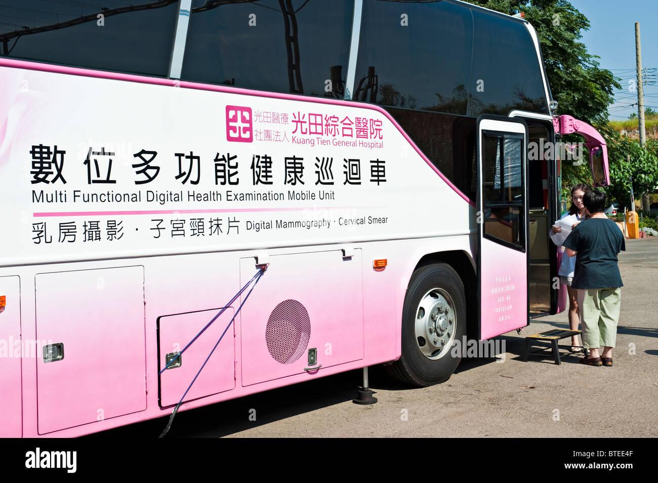 Doctor receiving patient at mobile women's health exam bus