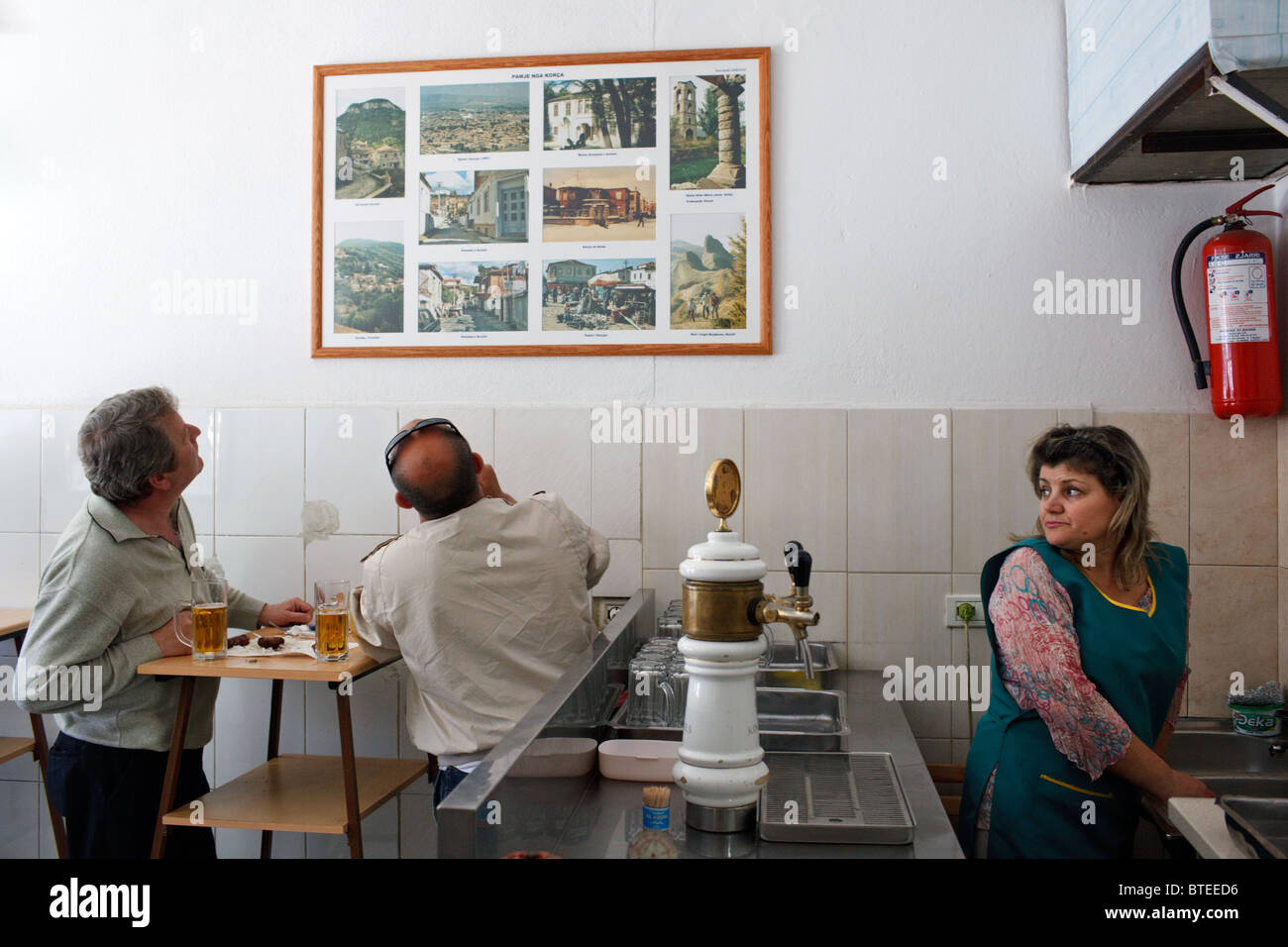 Inside a local bar serving kebabs and beer in Tirana, the capital of Albania. - Stock Image