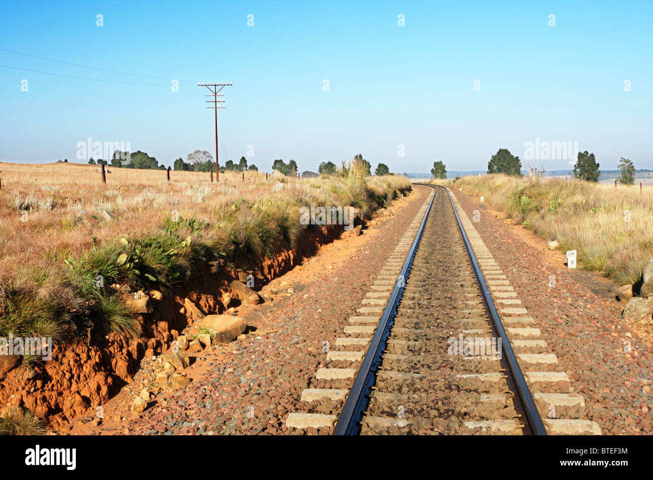 Railway line disappearing into the distance - Stock Image