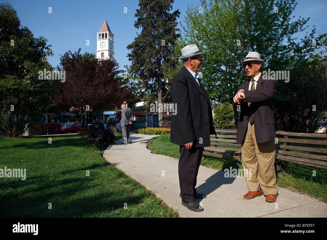 Two elegant old men in a park in the city centre of Tirana, the capital of Albania. - Stock Image