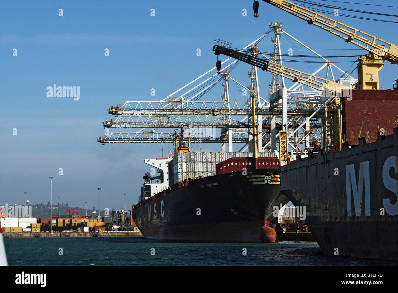 Ships and cranes anchored at Durban harbour - Stock Image