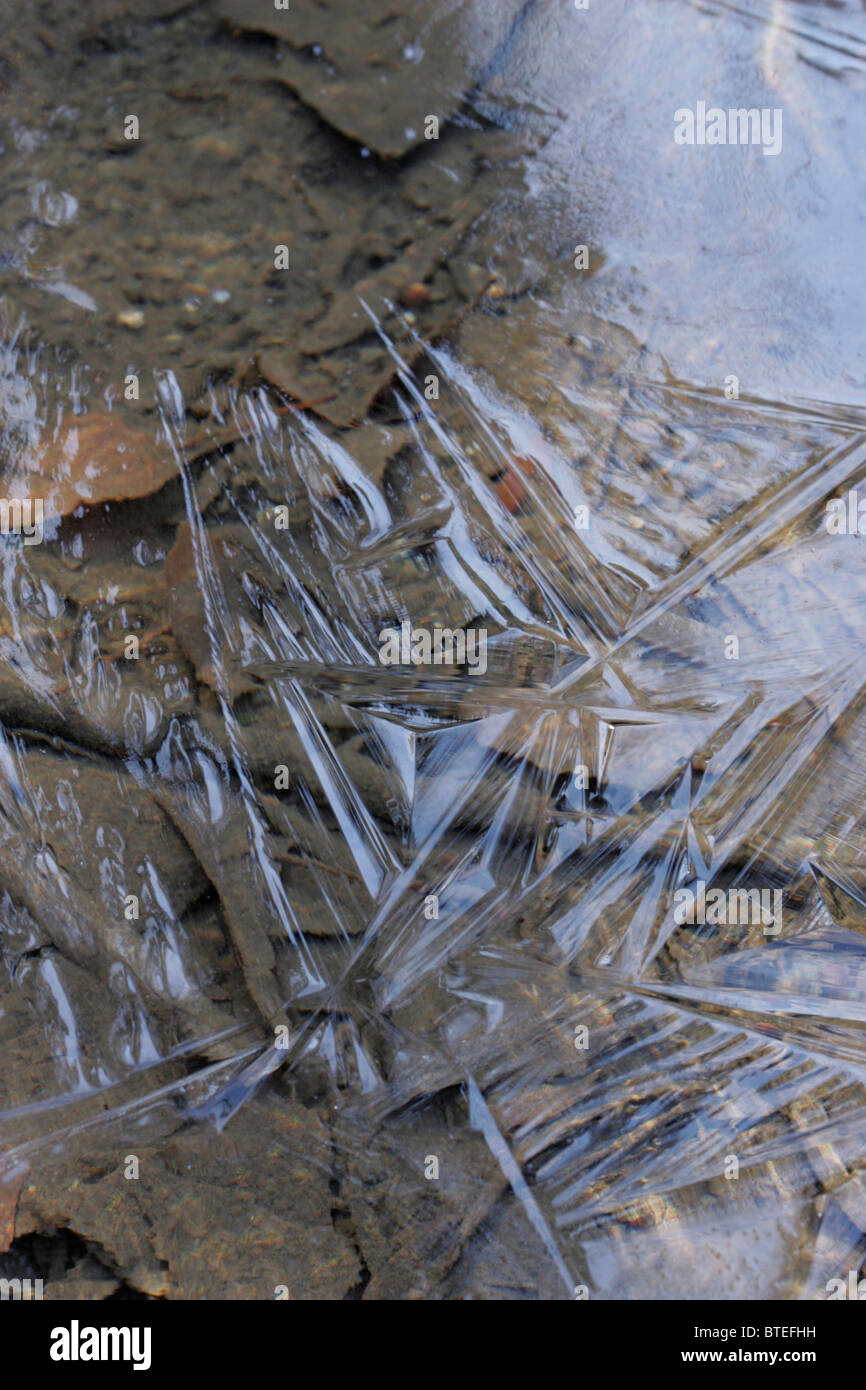 Ice crystals on surface of stream - Stock Image