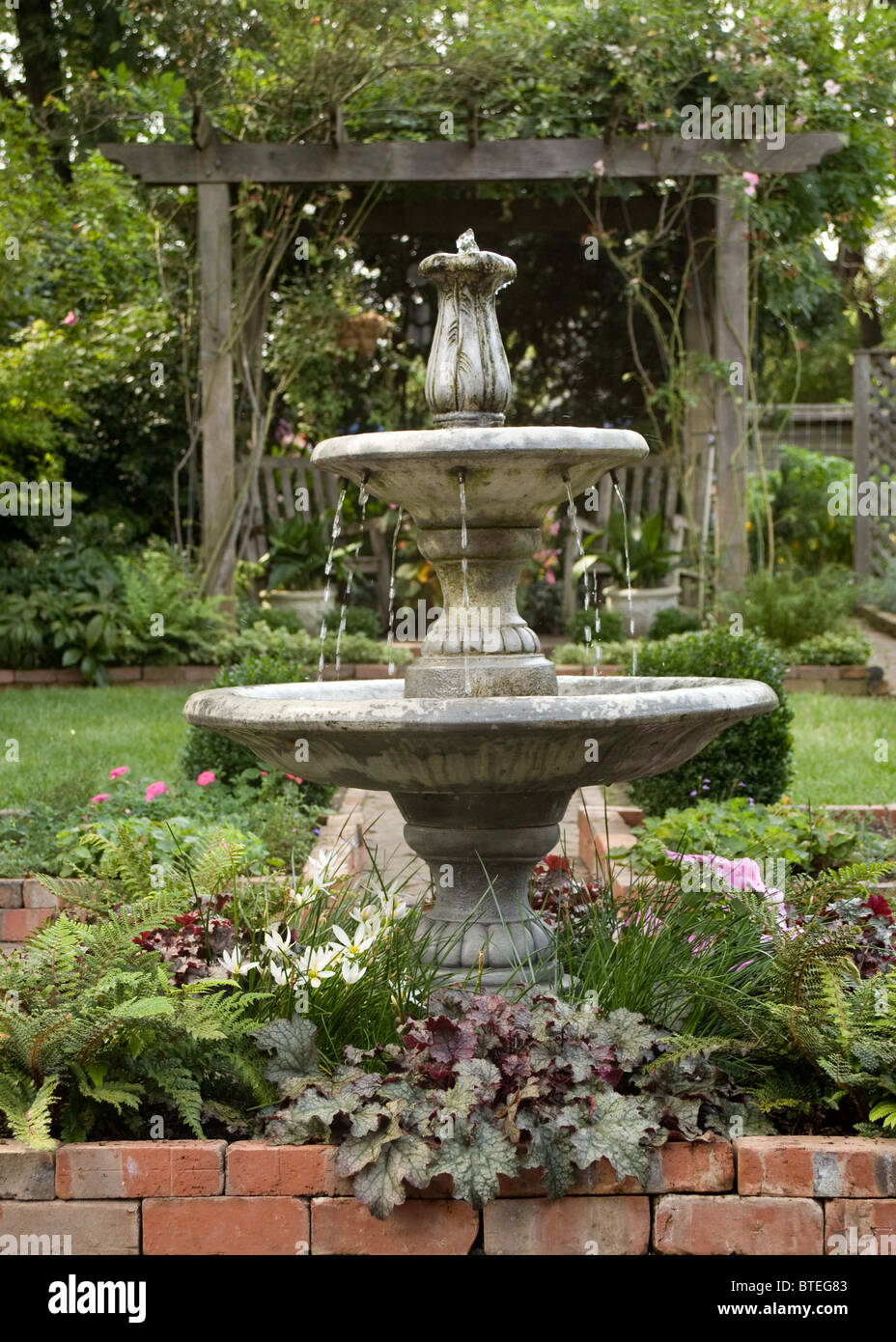 Water fountain in front of the garden arbor Stock Photo: 32282211 ...
