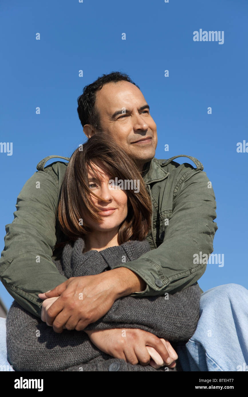 Mature couple relaxing together outdoors - Stock Image