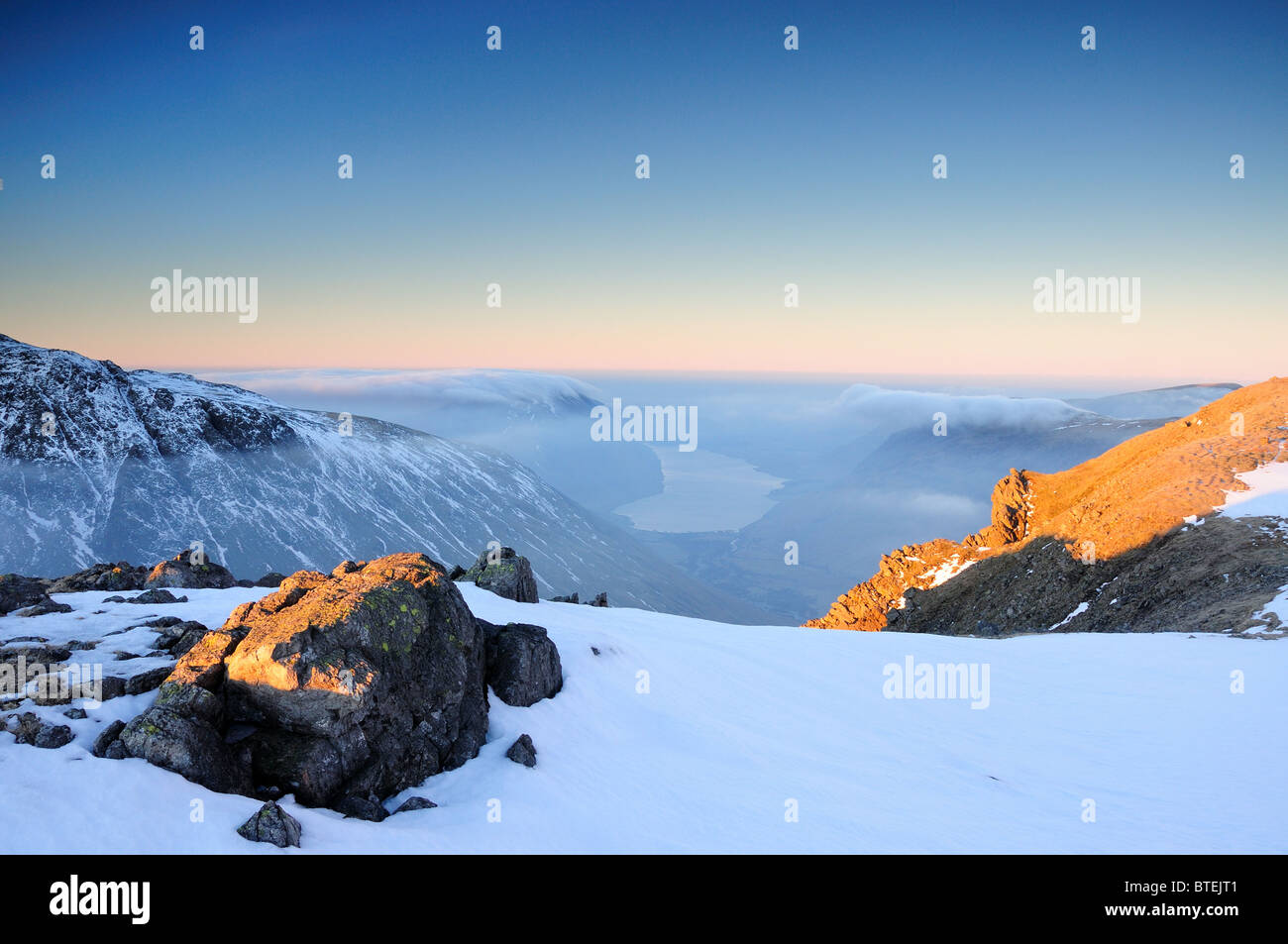 Winter sunrise view over Scafell, Wasdale and Wastwater from Great Gable in the English Lake District Stock Photo