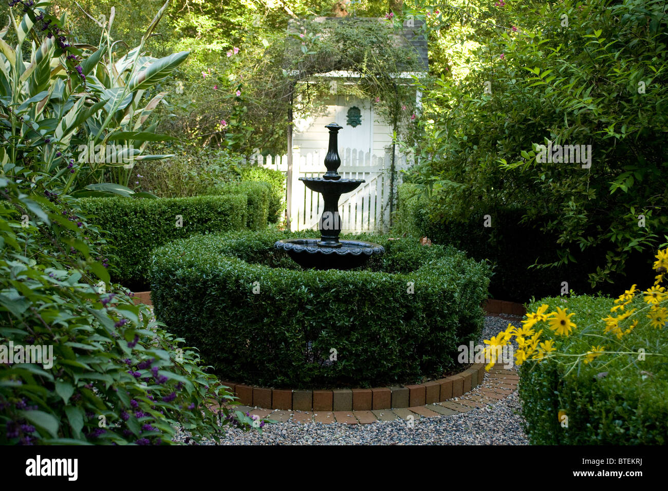 Small Garden Courtyard With A Fountain Water Feature.   Stock Image