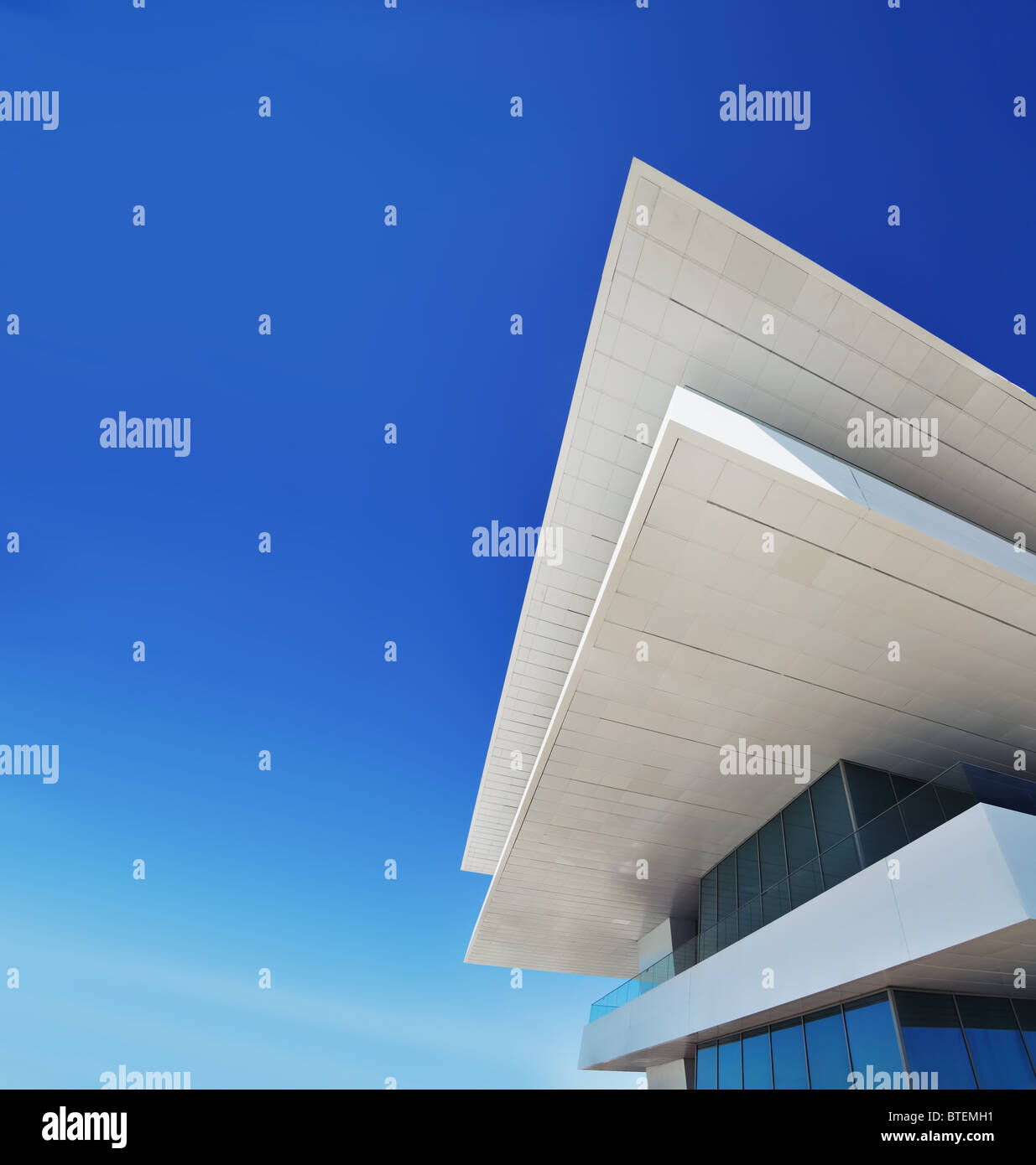 Modern architecture building detail against blue sky with copy space - Stock Image