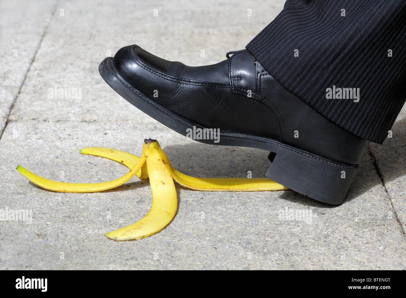 Falling on a banana skin - Stock Image