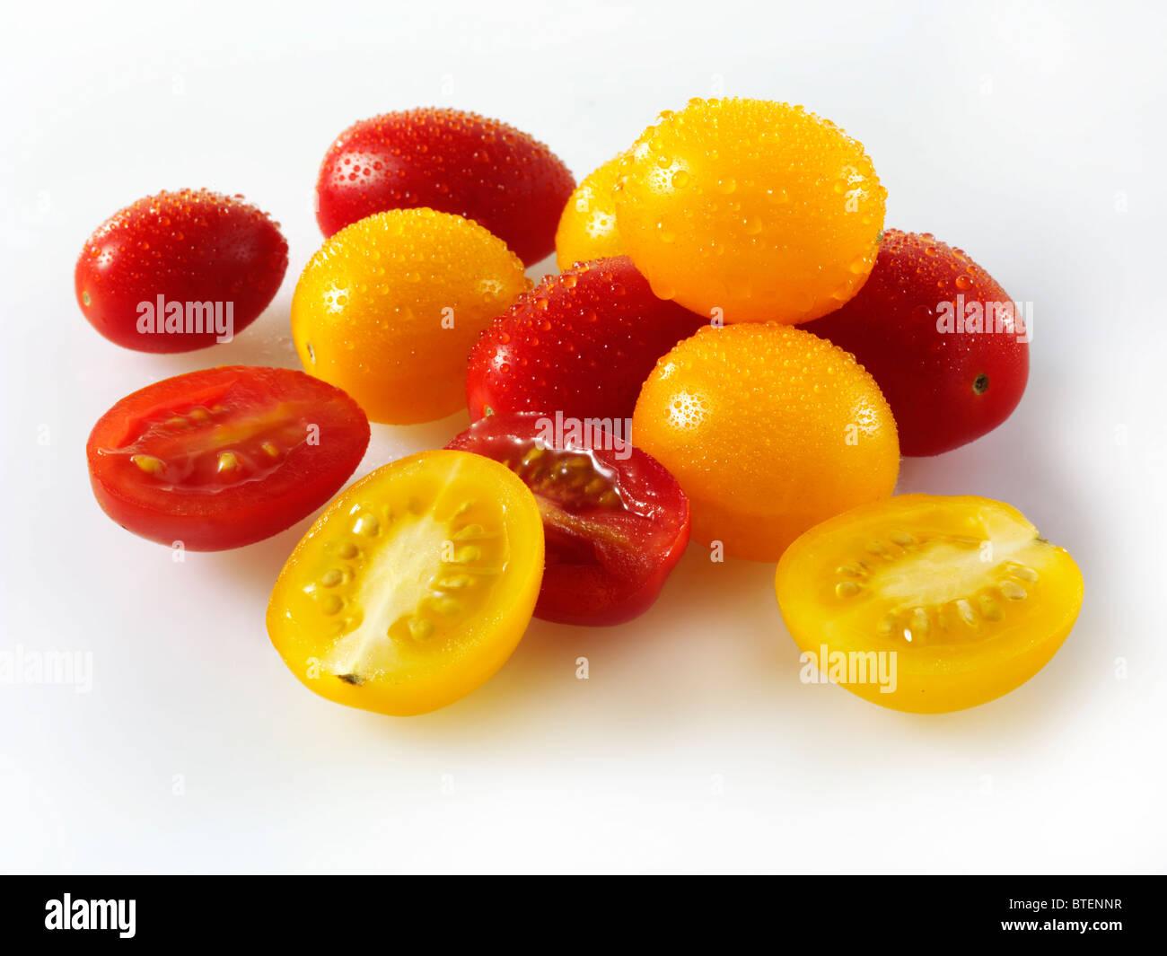 Mixed fresh yellow & red Pomodorino Tomatoes - Stock Image