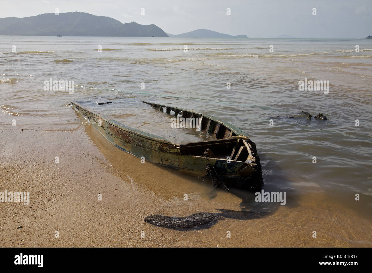 A boat that has seen better days in Chalong bay, Phuket Thailand - Stock Image