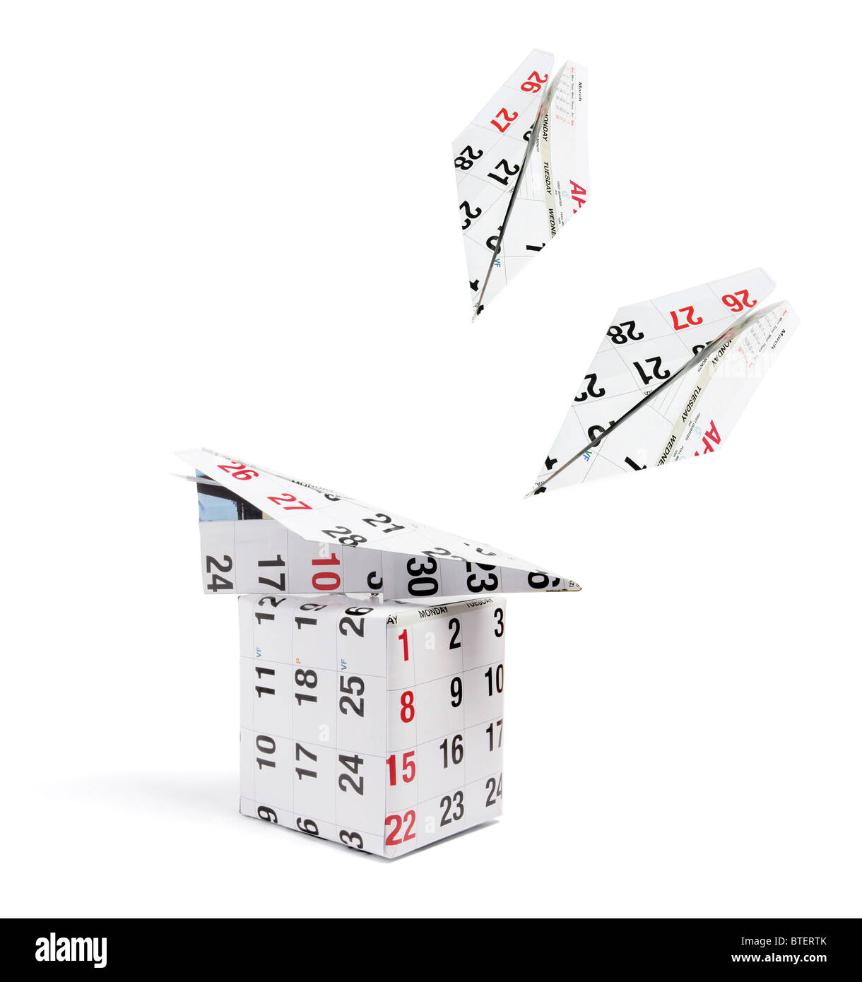 Gift Parcel and Calender Paper Planes - Stock Image