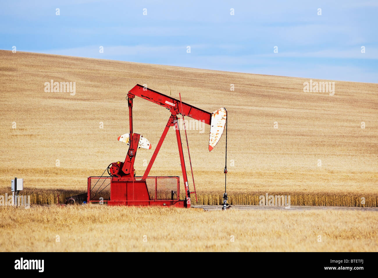 Oil well pump jack, near Swift Current, Saskatchewan, Canada. - Stock Image