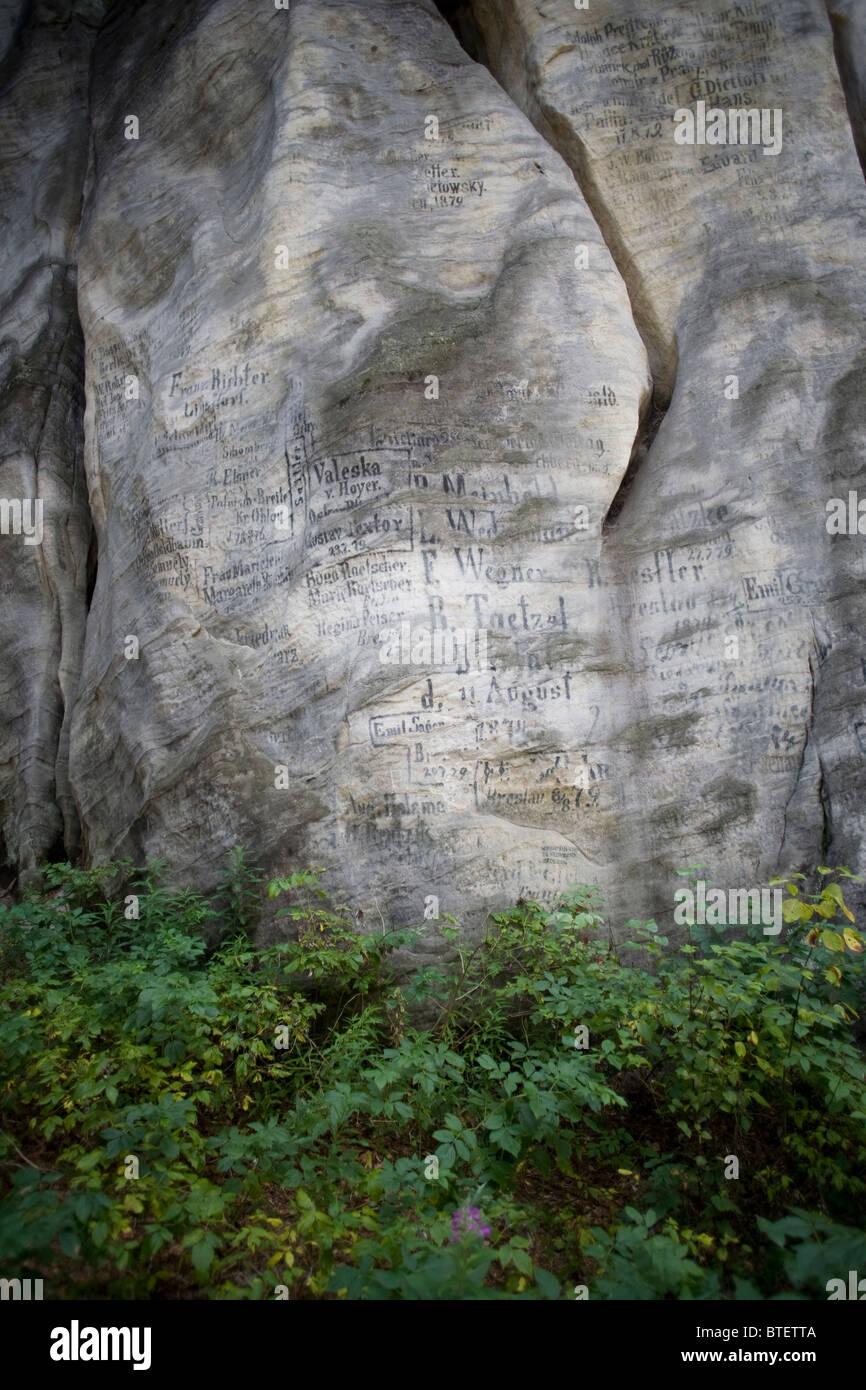 Composite of writting on rocks - Stock Image