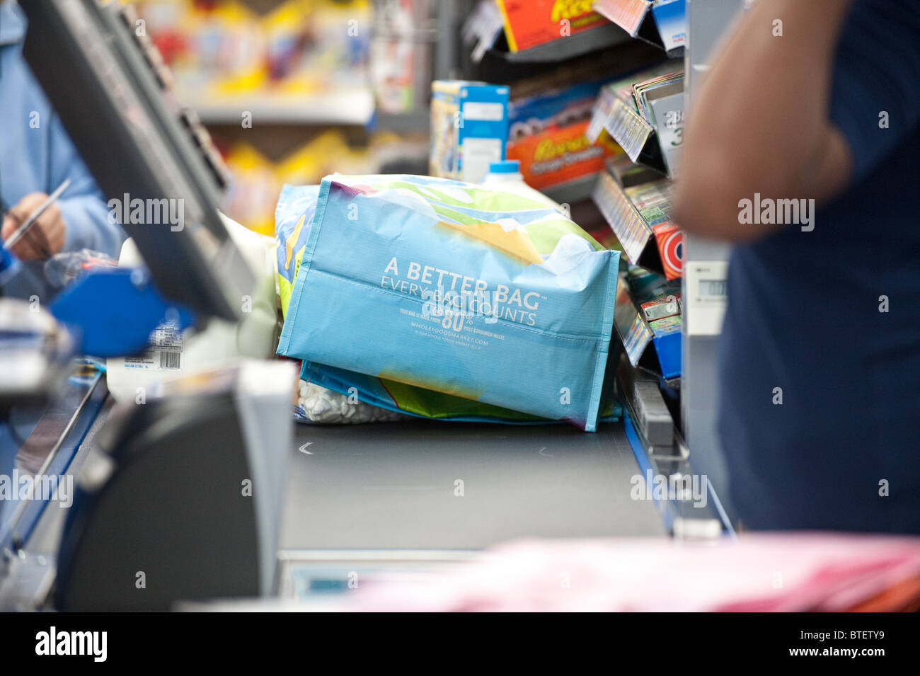 Customer uses reusable shopping bag at Wal-Mart in Austin, Texas. ©Marjorie Kamys Cotera - Stock Image