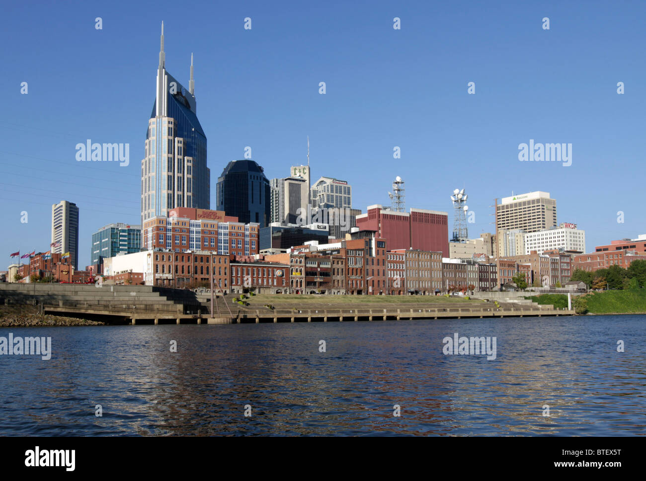 Skyline of Nashville with the AT&T corporate building towering over the historic district of Broadway - Stock Image