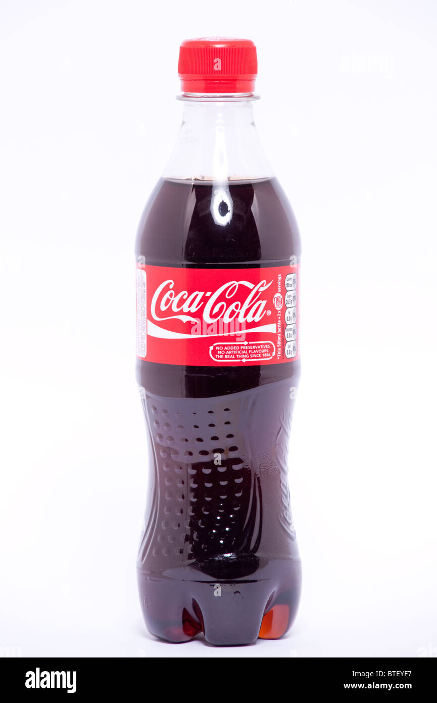 A close up photo of a 500ml bottle of coca-cola against a white background - Stock Image