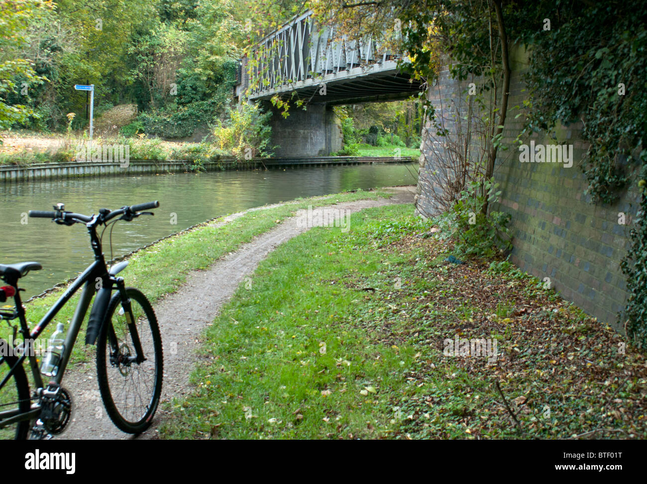 Bicycle on Canal Path next to  Water - Stock Image