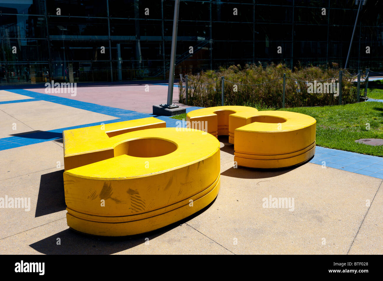 Bold yellow number 53 on the ground. - Stock Image