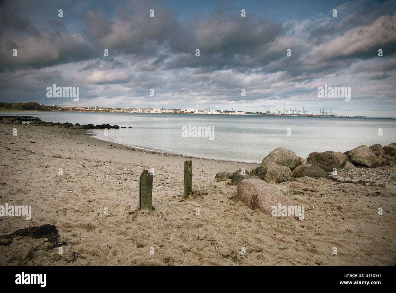 Aarhis beach with town in background - Stock Image