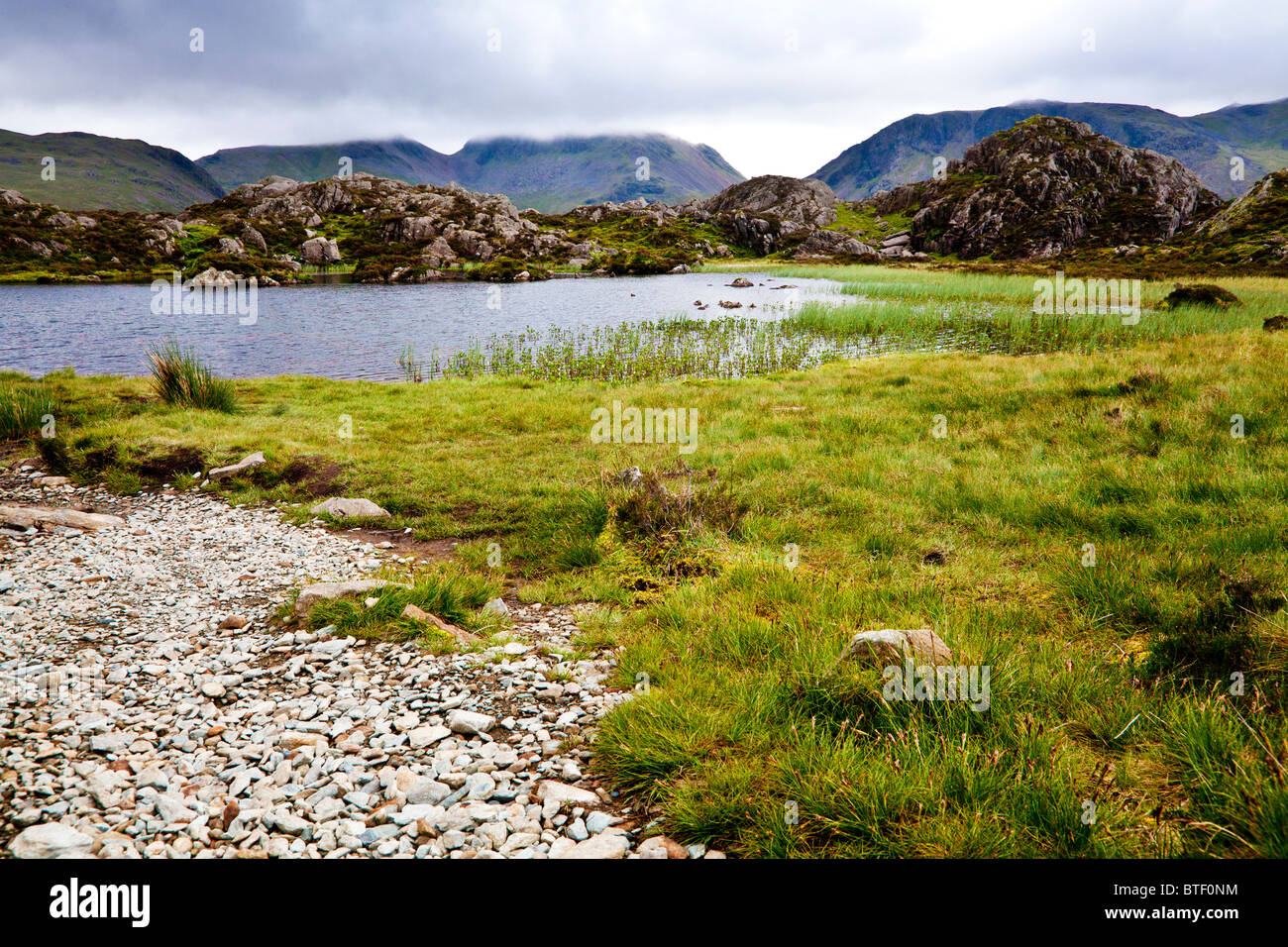 Innominate Tarn on the summit of Haystacks in the Lake District, Cumbria, England, UK Stock Photo