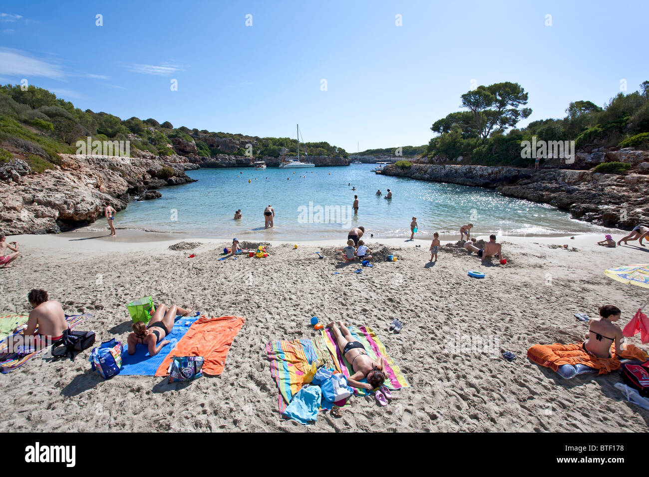 People sunbathing. Cala Sa Nau beach. Felanitx. Mallorca Island. Spain Stock Photo