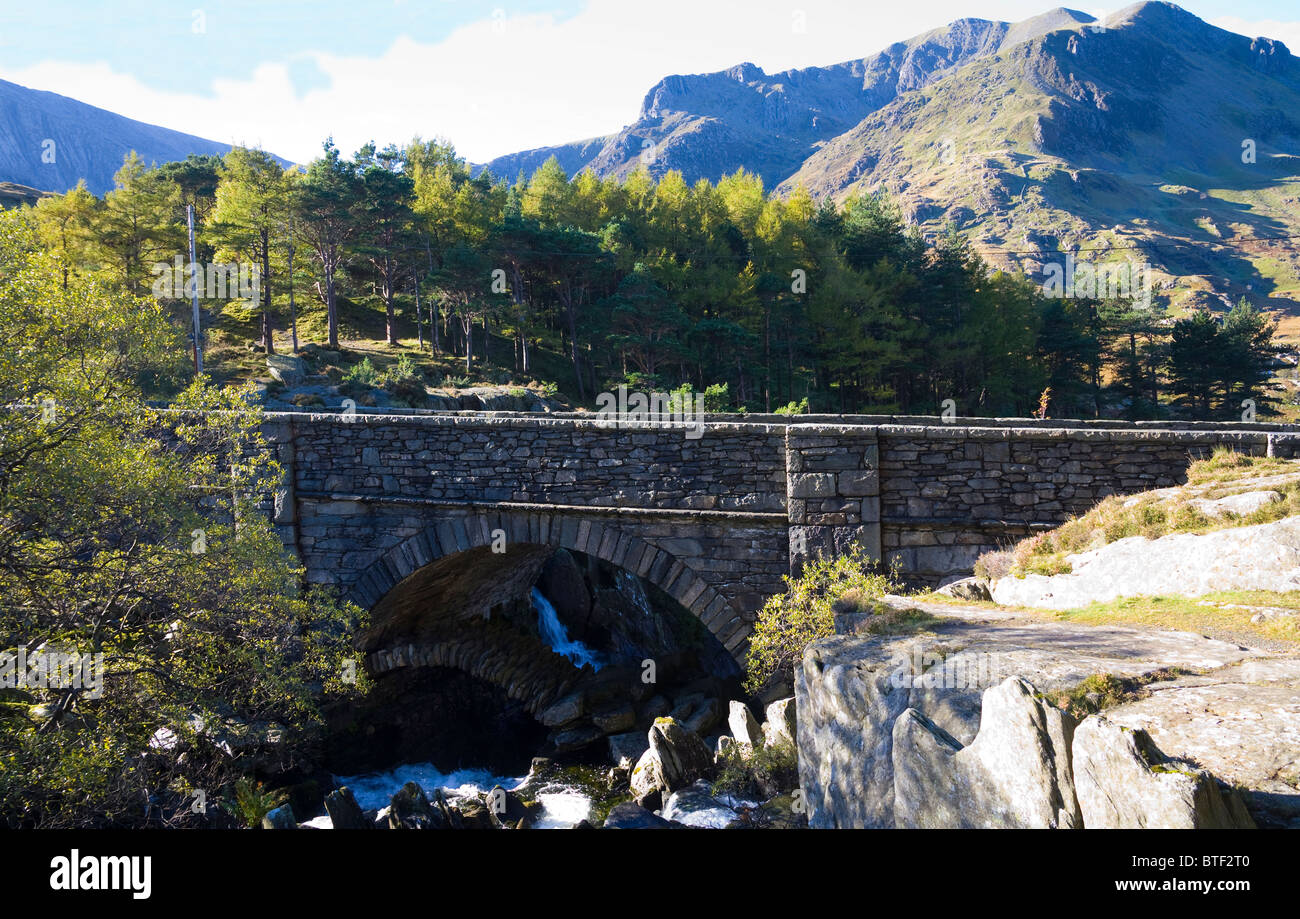 Ogwen Valley Conwy North Wales UK October Arfon Ogwen flowing under the old packhorse bridge Snowdonia National - Stock Image