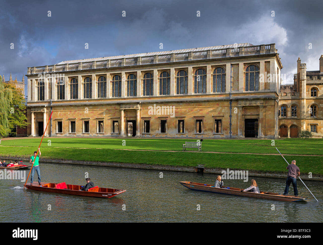 The Wren Library, Trinity College Cambridge, with punting in front on the river Cam - Stock Image