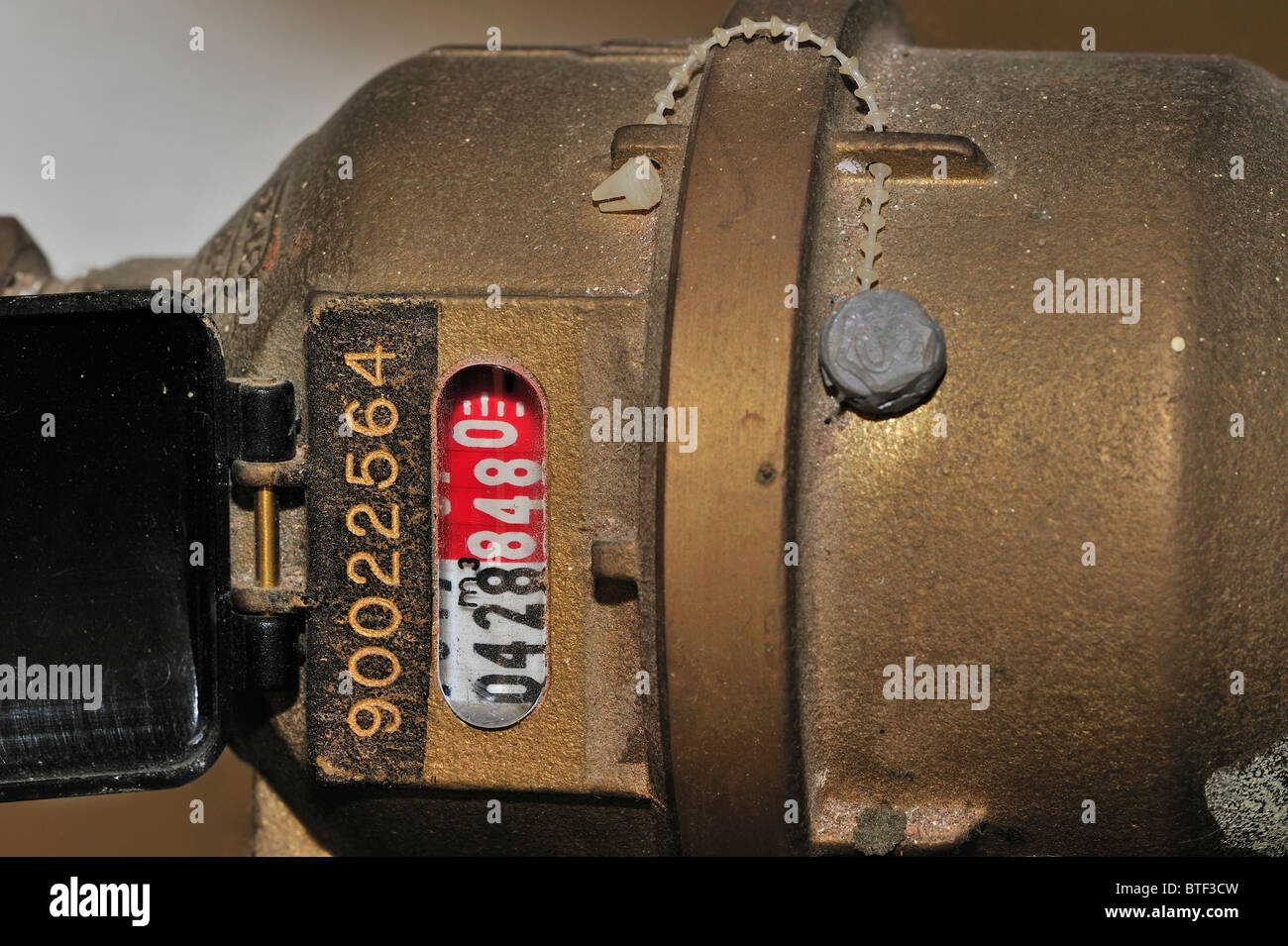 Water meter used to measure the volume of domestic water usage - Stock Image