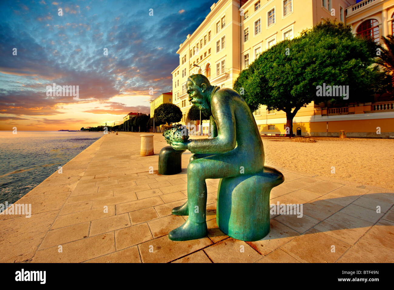 Neo classic Austrian seafront with 'The Old Man Of The Sea Statue', Zadar, Croatia - Stock Image
