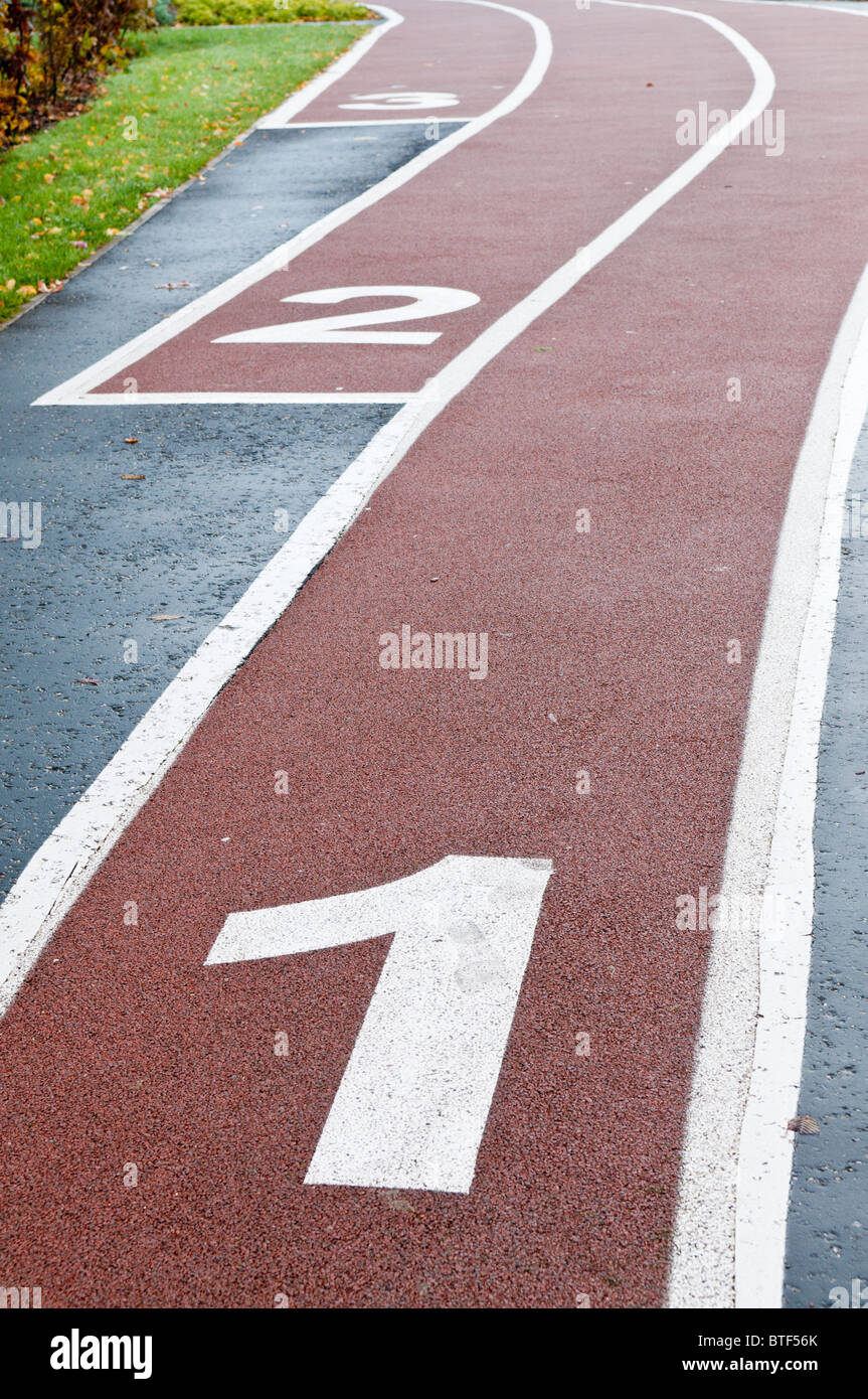 Numbers 1, 2 and 3 at the start of a running track - Stock Image