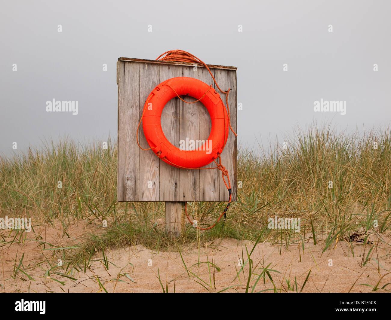 Life Buoy on Embleton Beach, Northumberland - Stock Image