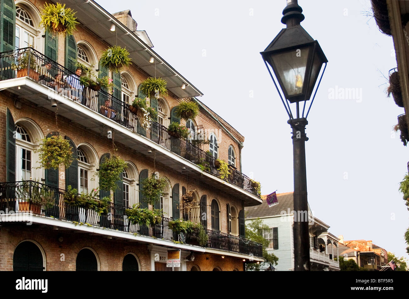 french quarter balconies and gas street lamp new orleans la usa