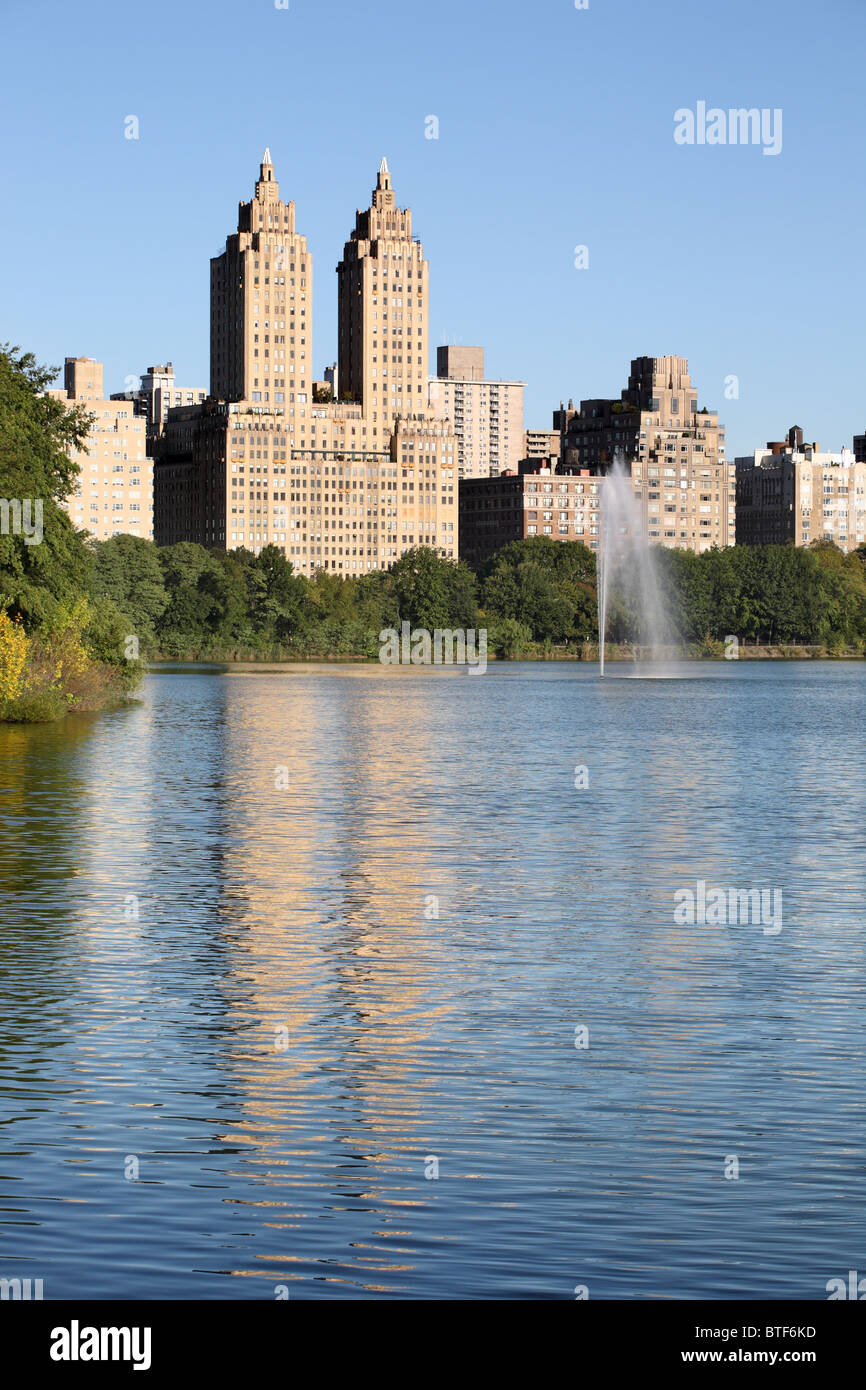 The Eldorado apartment block on 300 Central Park West, seen reflected in the reservoir. New York USA - Stock Image