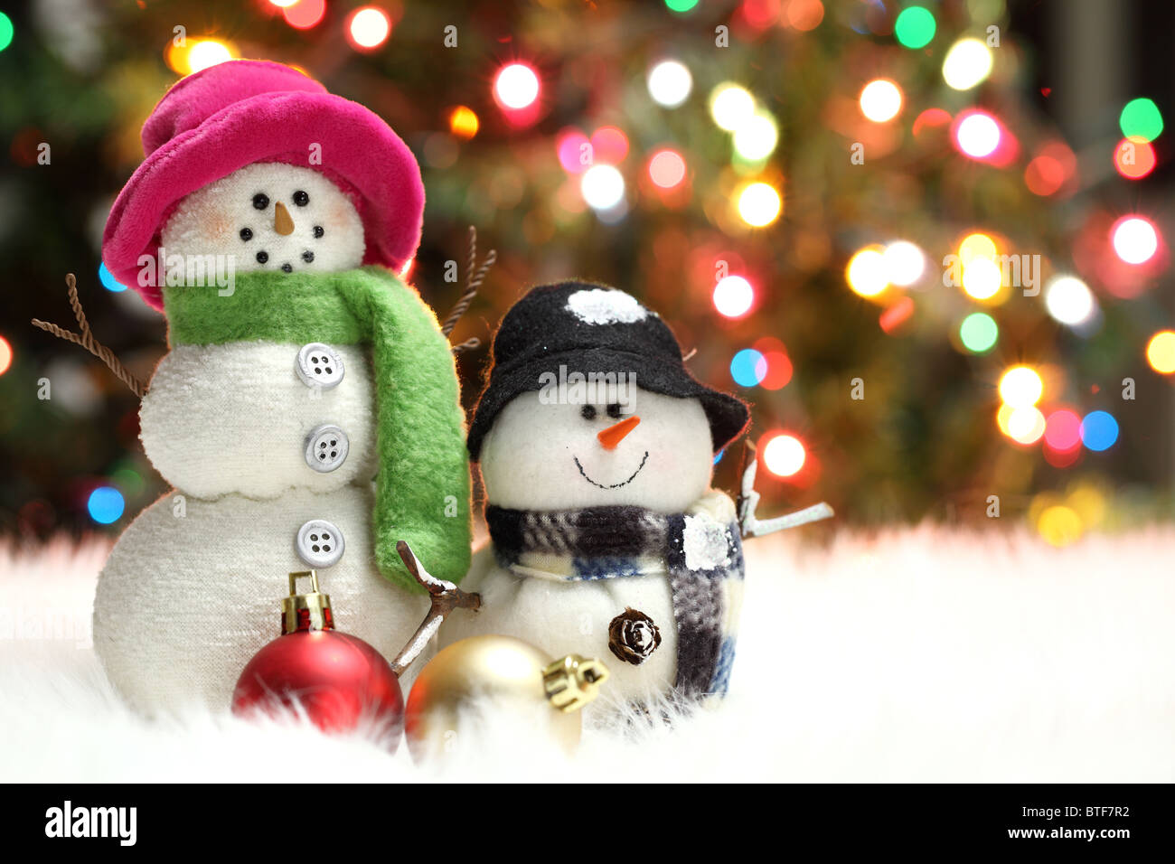 Festive snowman with Christmas light background - Stock Image