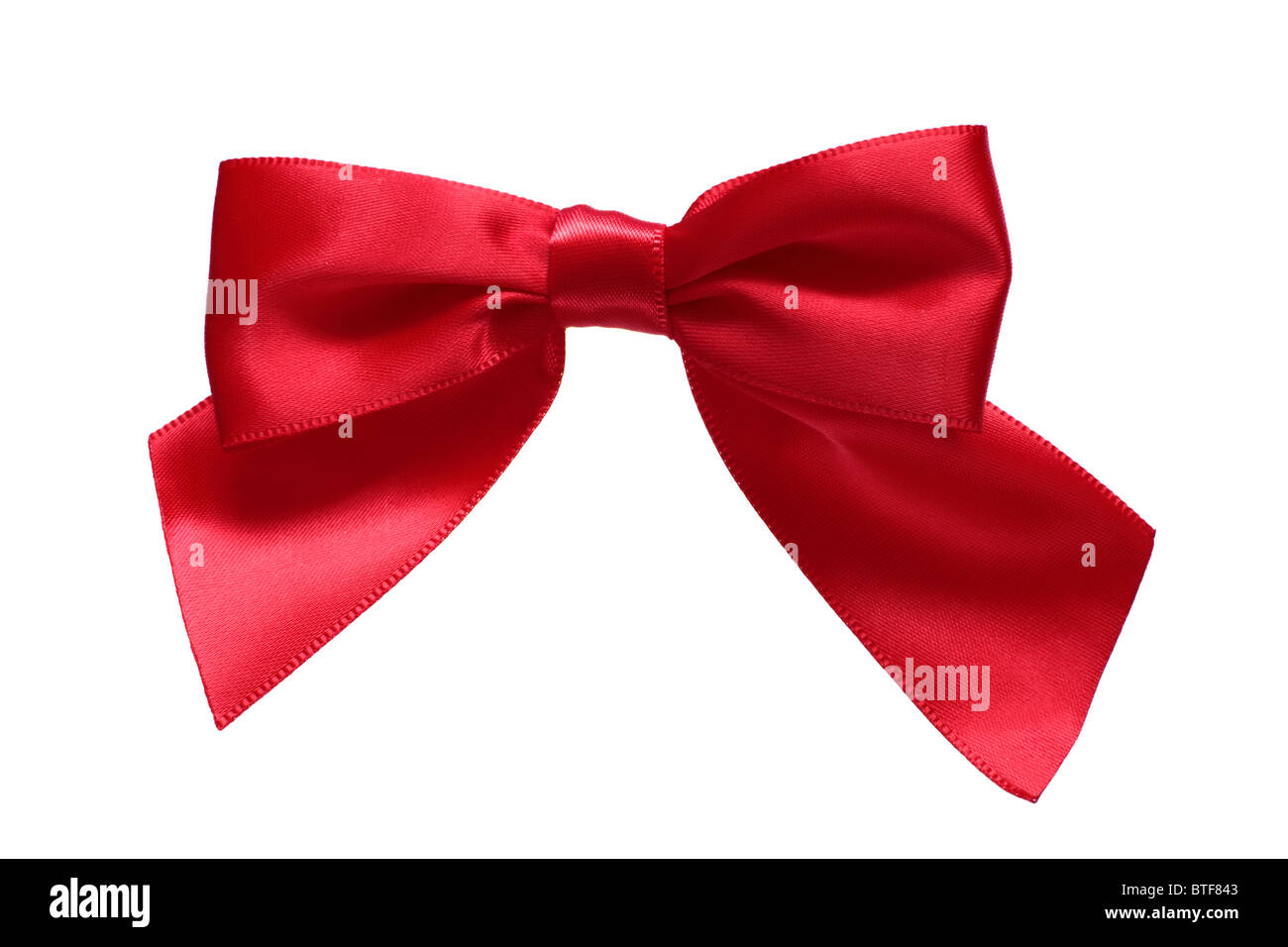 Red ribbon bow on a pure white 255/255/255 background. This pure white background means it can be rotated to suit - Stock Image