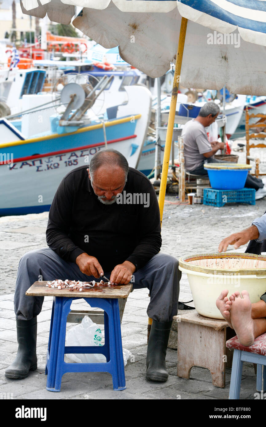 Fishermen by the port in Kos Town, Kos, Greece. - Stock Image