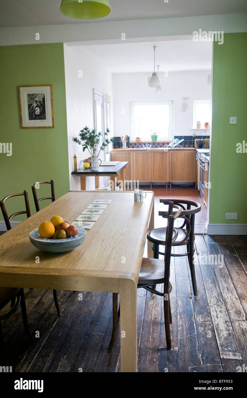 Shabby chic kitchen dining room in Edwardian terraced house - Stock Image