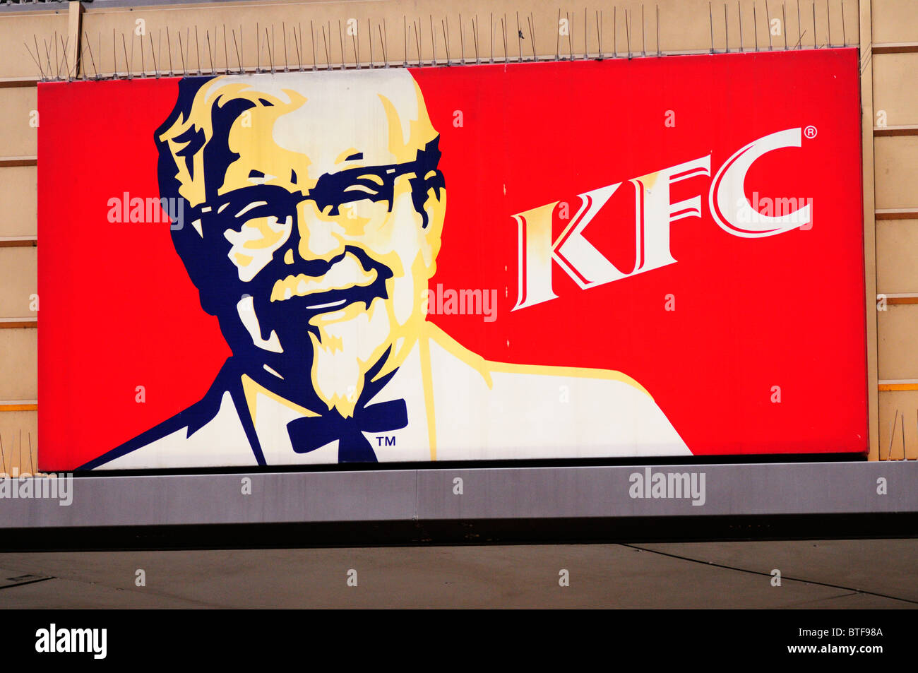 Kentucky Fried Chicken KFC fast food restaurant sign symbol, London, England, UK - Stock Image