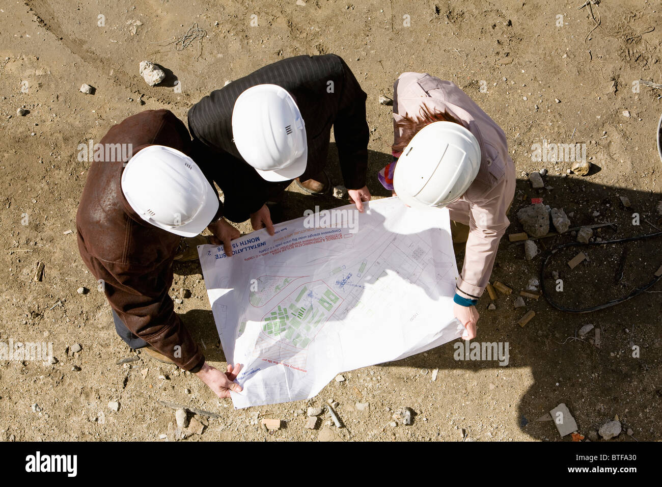 Property developer and business people reviewing blueprint - Stock Image