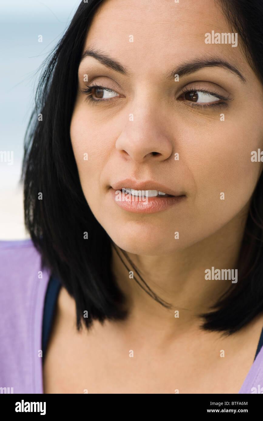 Female looking away, portrait - Stock Image