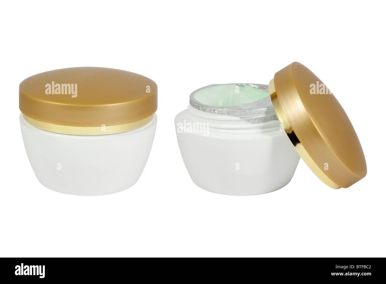 Pot of moisturizing face cream. Isolated on white background. - Stock Image