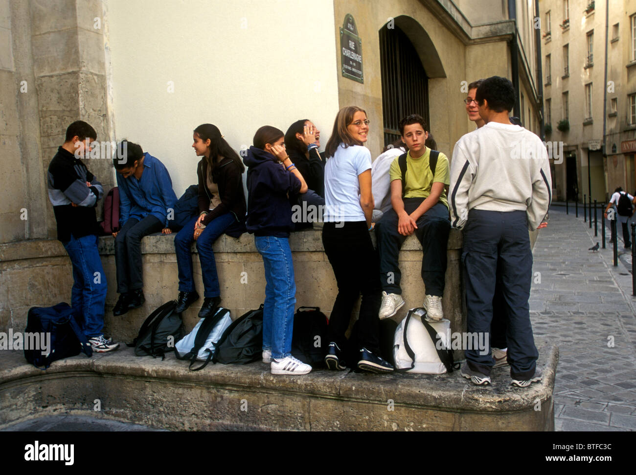 French high school students schoolboys and schoolgirls getting together at recess at Lycee Charlemagne in the Marais - Stock Image